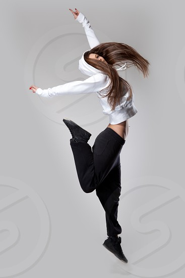 attractive jumping woman photo