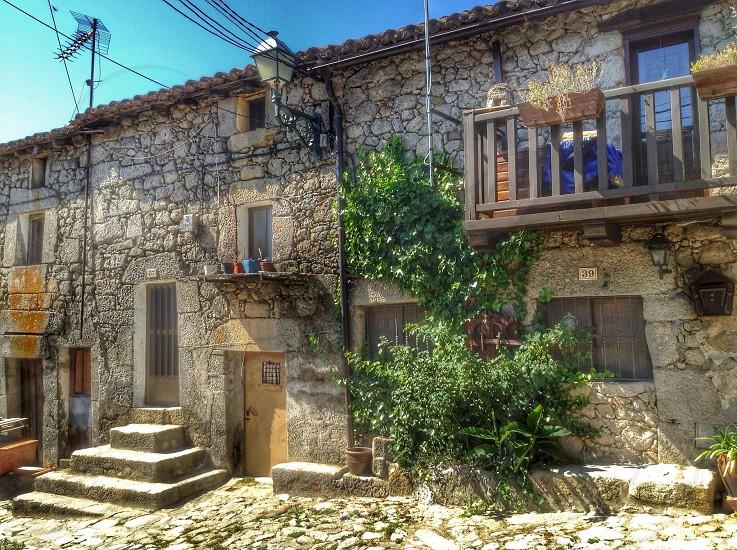 grey stoned house with veranda photo