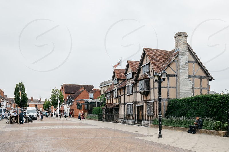 Front view of Shakespeare Birthplace along Henley Street a cloudy day photo