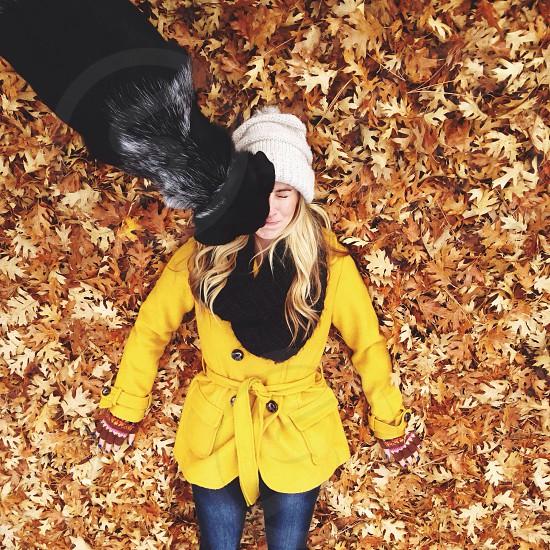black dog kissing woman photo