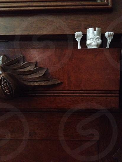 white skeleton inside wooden drawer photo