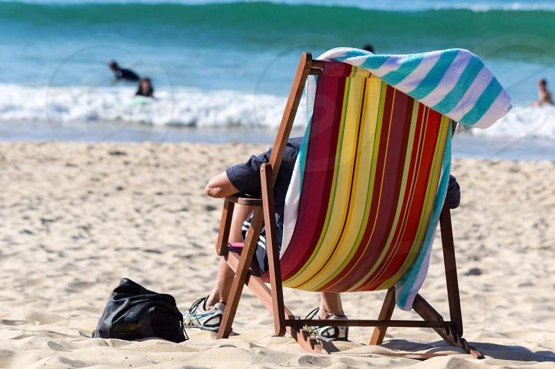A day at the beach deck chair stripes sun sand relax photo