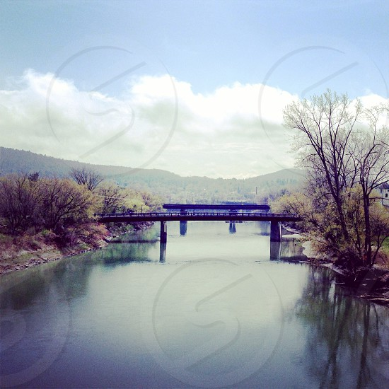 Vermont spring day. River landscape with rail roads and bridges photo