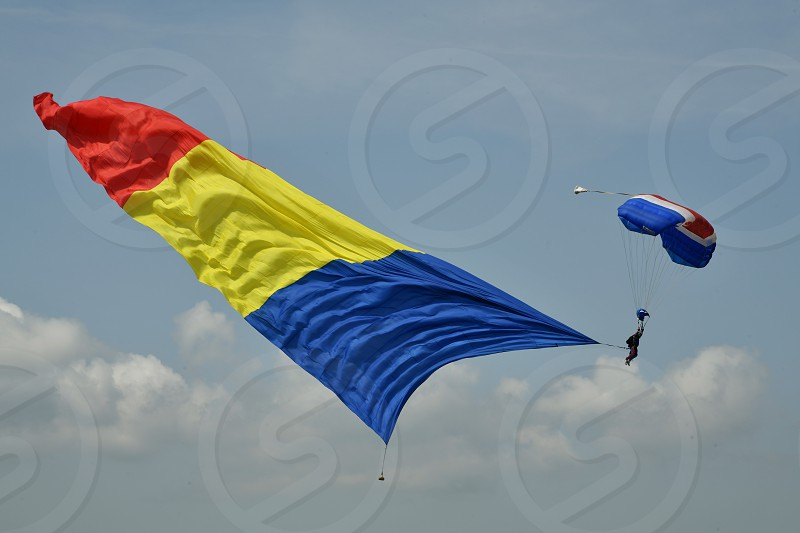 Flying parachutist with Romanian flag photo