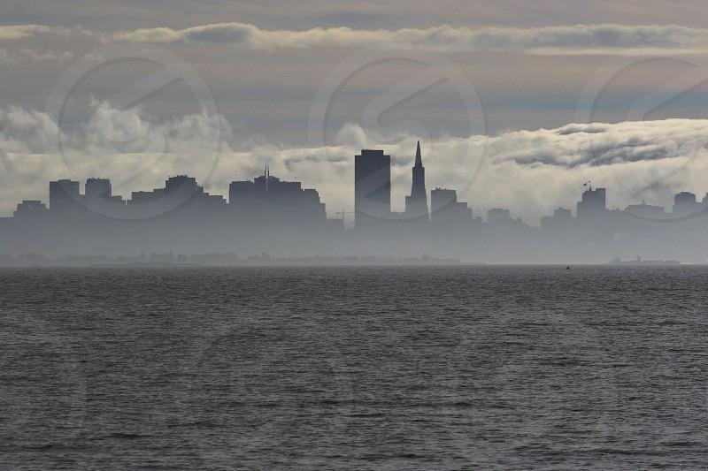 San Francisco nestled in the Fog San Francisco Fog Silhouette photo