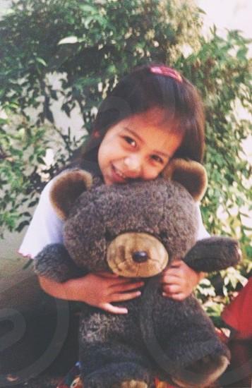 Cute girl with teddy bear photo