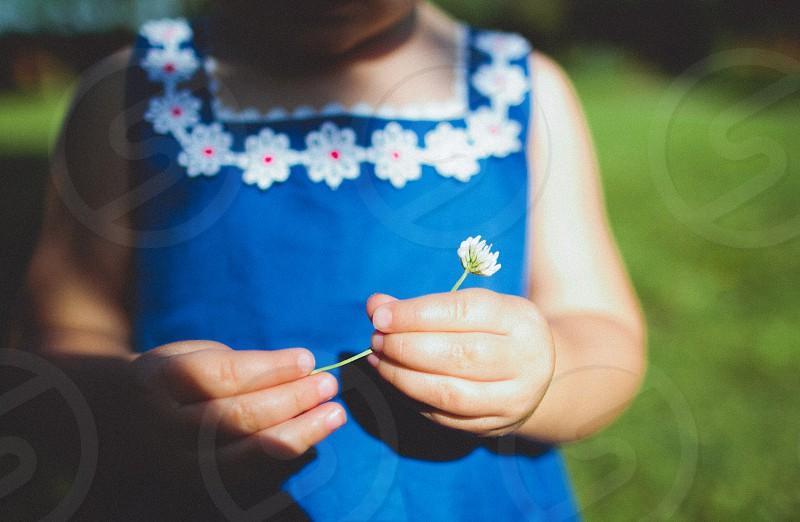 child children kid summer flower hands outside lifestyle family photo