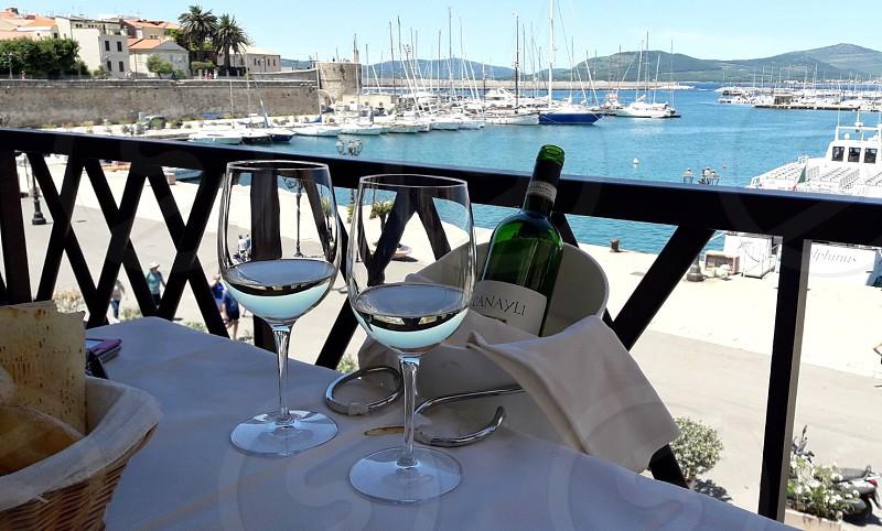 glasses of italian wine in a scenic view photo