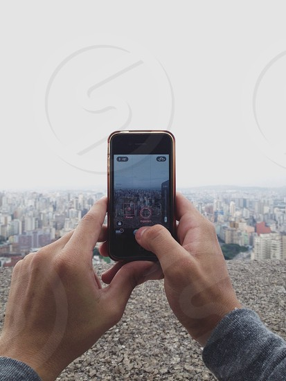 person taking a picture on the roof photo