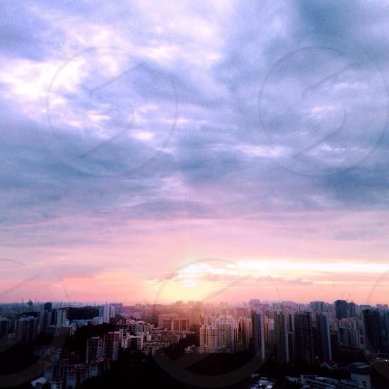 city buildings under cirrostratus clouds photo