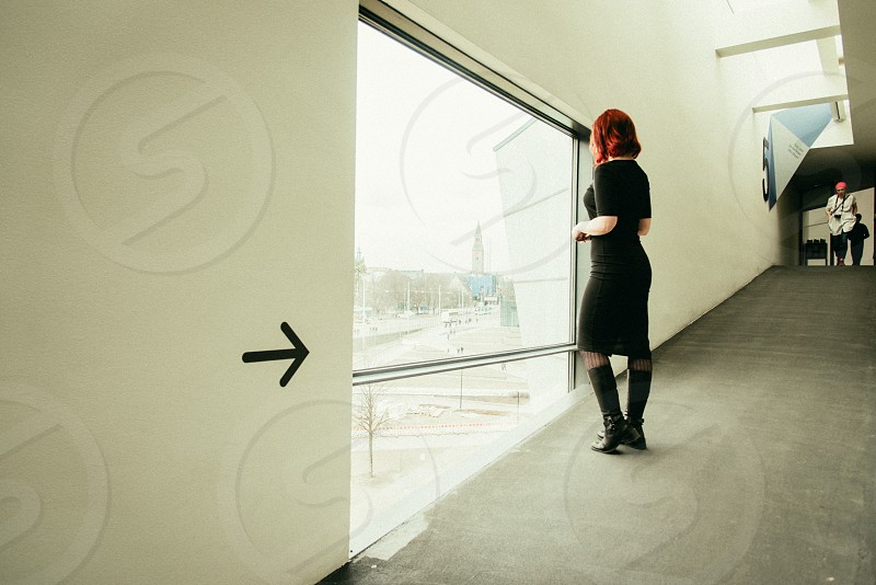 The Kiasma museum indoors. The walkway to the fifth floor and a woman looking outside. photo
