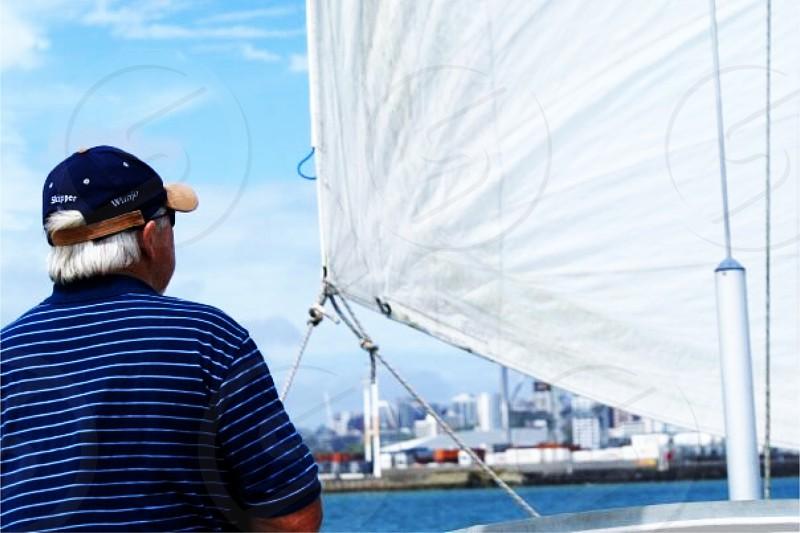 Grandpa sailing off the coast of Auckland New Zealand. photo