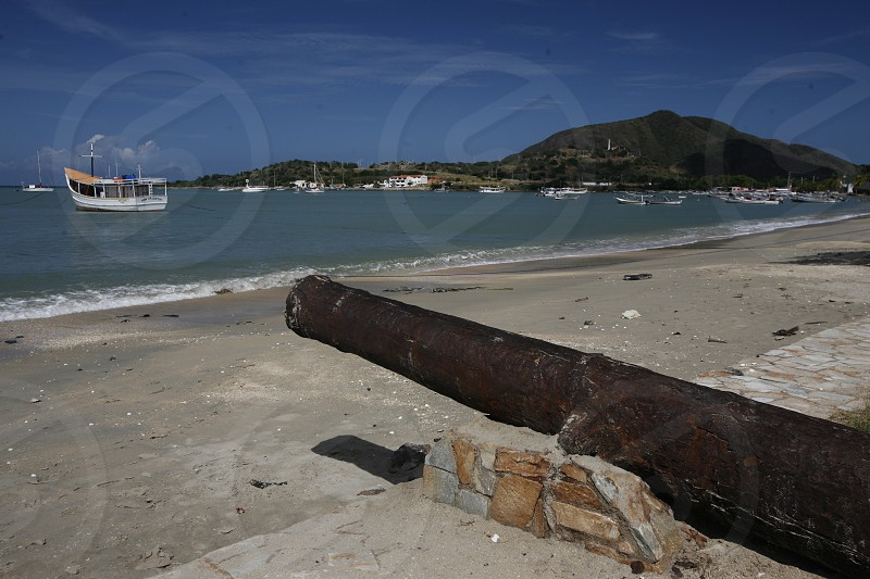 a canon at the beach in the town of Juangriego on the Isla Margarita in the caribbean sea of Venezuela. photo