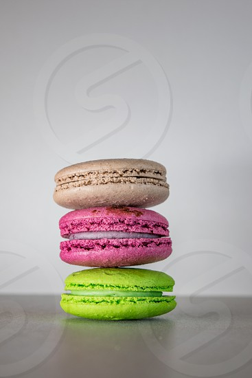 Three colorful macaronis tower isolated on white background photo