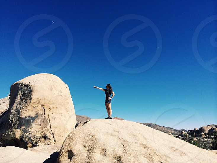 woman standing on large rock photo