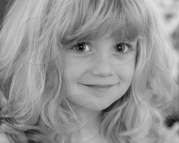 Girl black and white smile eyes photo