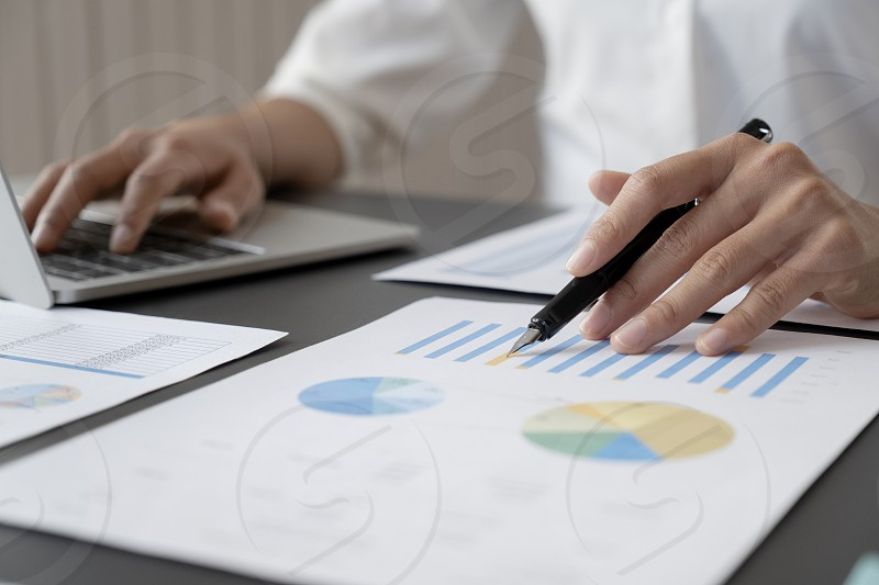 Businessman planning and analyse investment marketing data. photo