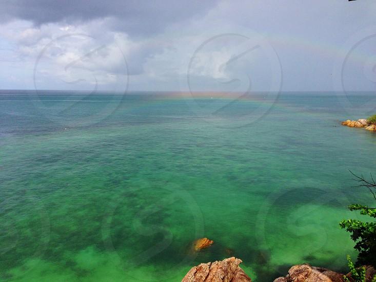 Rainbow above the sea. photo