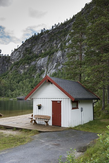 white typical wooden house in norway at the highlands near valle photo