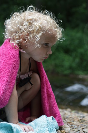 child in pink comforter photo