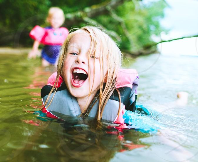 Kid child swim swimming summer lake photo