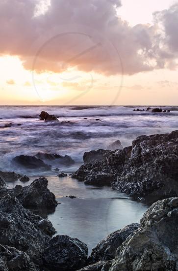 Ocean waves crashing during sunset on Maui Hawaii.   photo