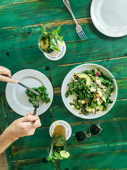 Greens food table wood farm to table salad photo