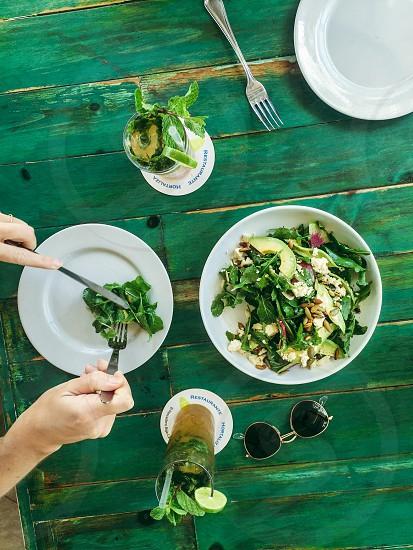 Greens food table wood farm to table salad photo
