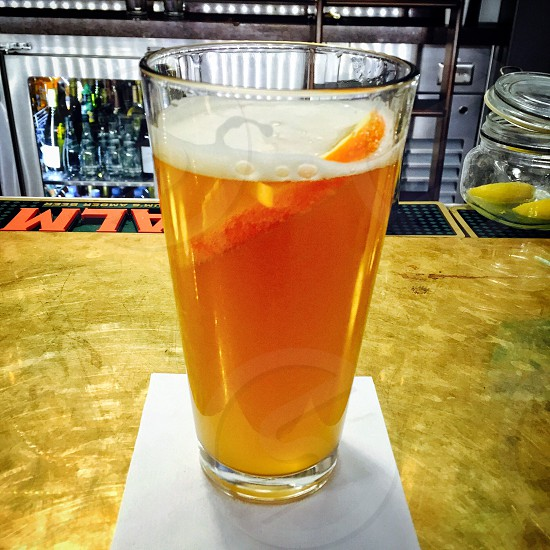Tap beer on a bar counter with orange slice photo