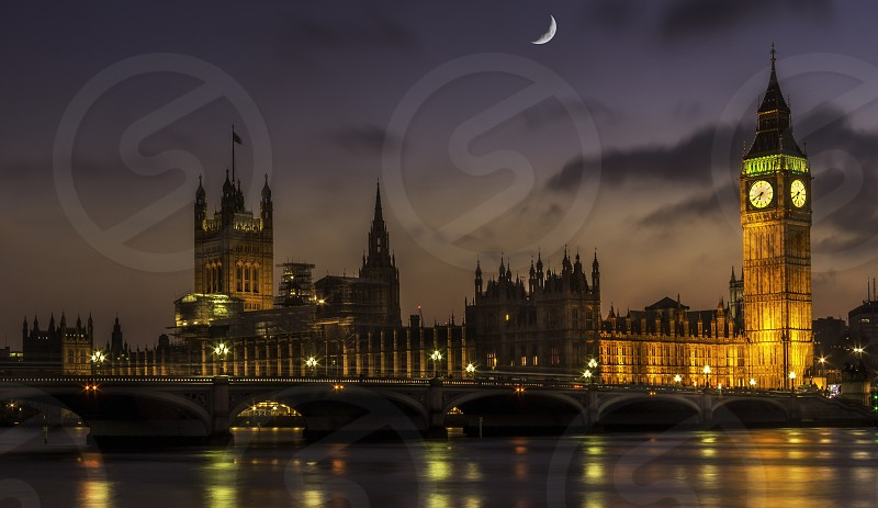 lovely sunset over the house of parliament photo
