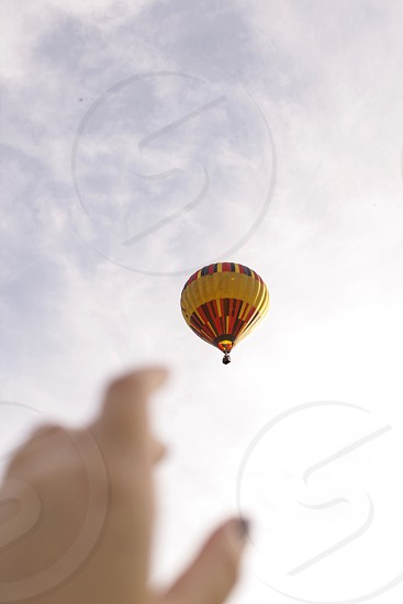 Hand balloon air balloon sky looking up adventure travel wanderlust photo