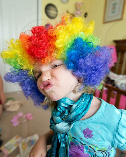 My daughter making in psychedelic clown wig. photo