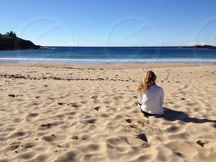 Girl beach sand sea sky photo