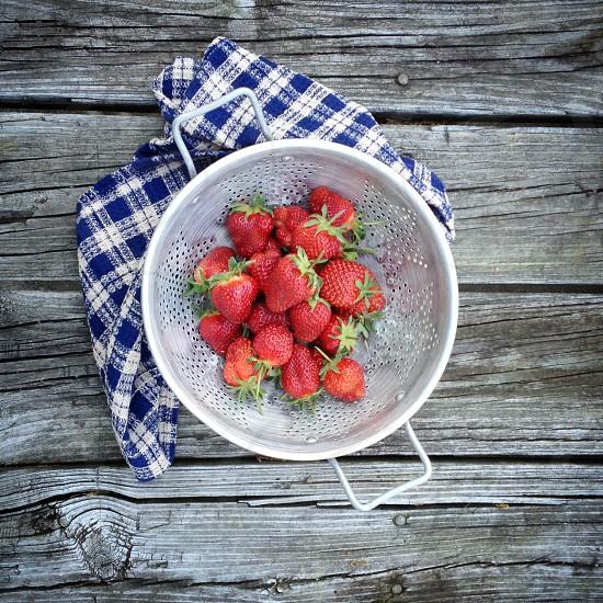 strawberries in strainer photo
