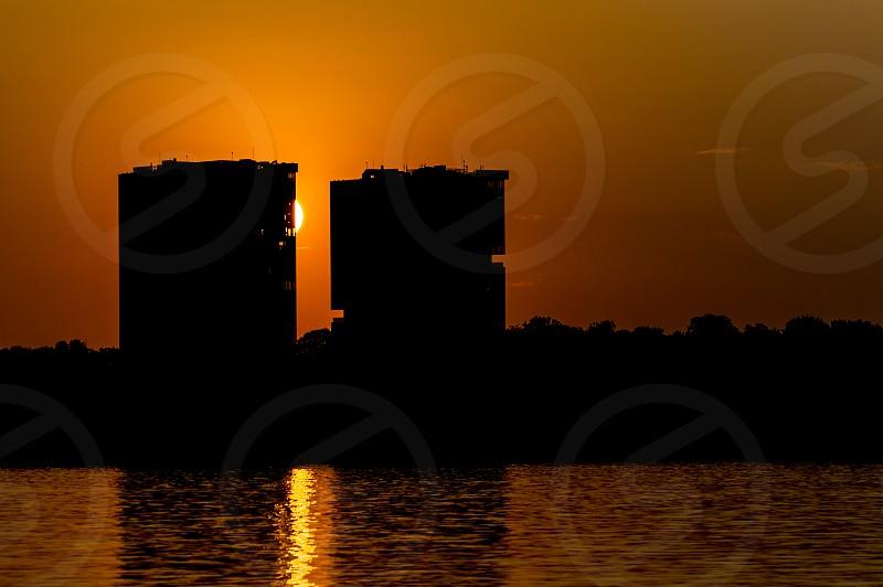 sunset lake city orange architecture twin buildings photo