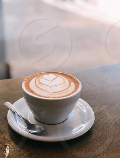 Coffee latte latte art coffee cup morning breakfast coffee shop photo