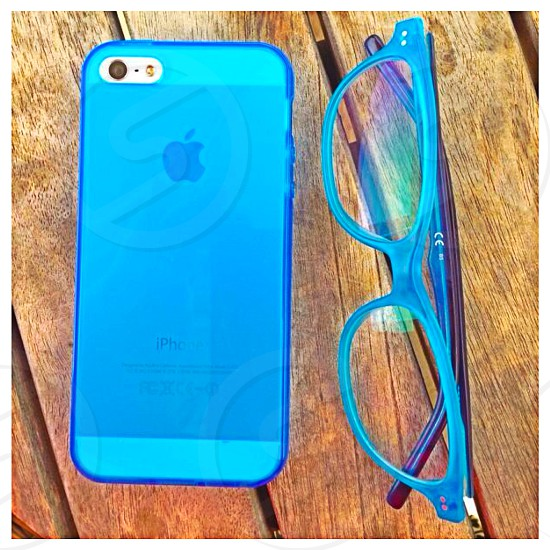 phone and glasses on the table photo
