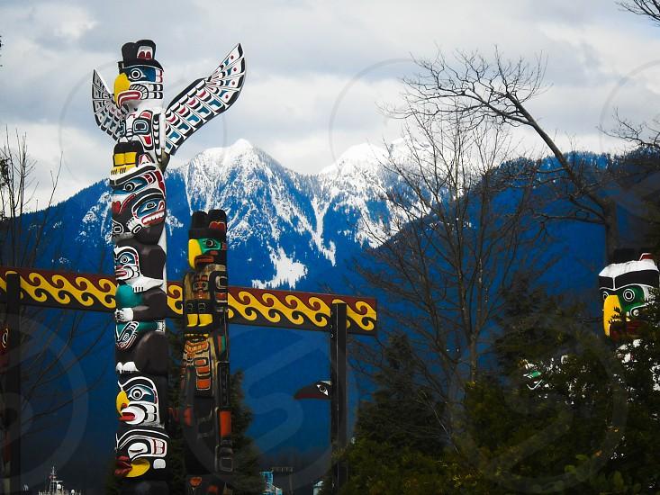Totem poles in Stanley Park photo