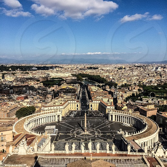 birds eye view of st. peters basilica under blue and white cloudy sky during daytime photo