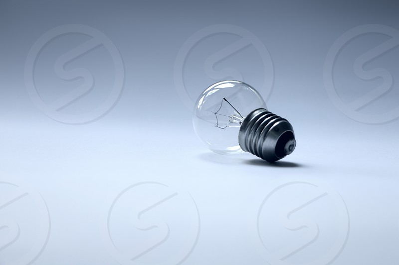 Close up of an old classic tungsten bulb with filament photo