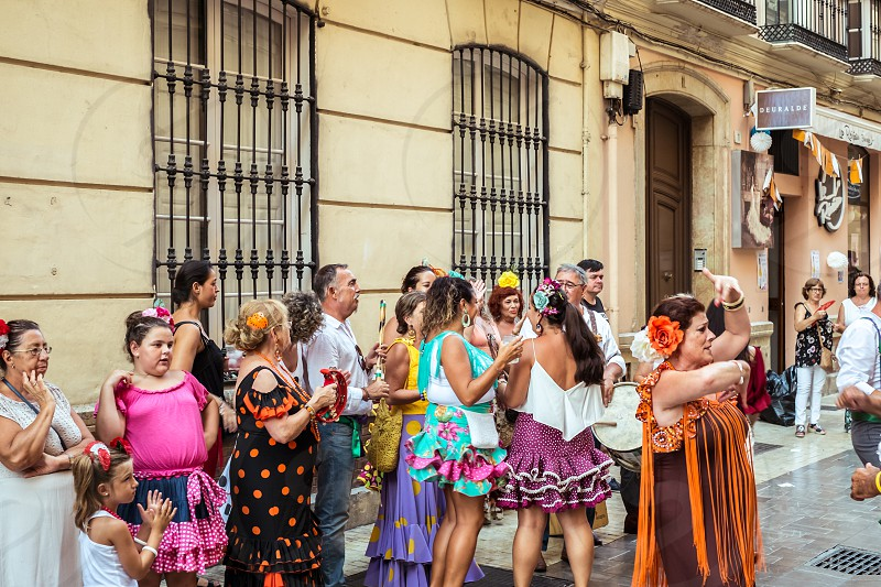 Malaga Spain - August 12 2018. People having fun on the street at the Feria de Malaga an annual event that takes place in mid-August and is one of the largest fiestas in Spain photo