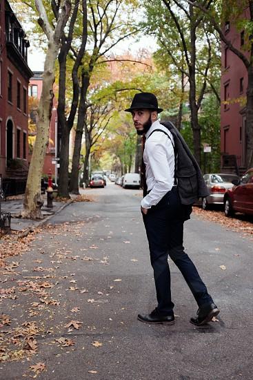 Manny walking in Brooklyn. dapper best dressed style fashion mens fashion men wear beard hat tie suspenders photo
