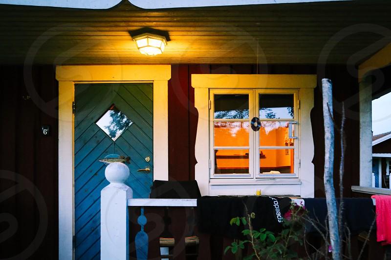 Cabin life cabin cozy door window light coziness  facade idyllic cute photo