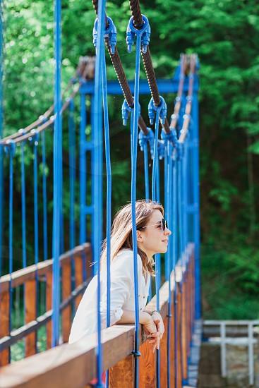 Young woman enjoying the view of the bridge photo