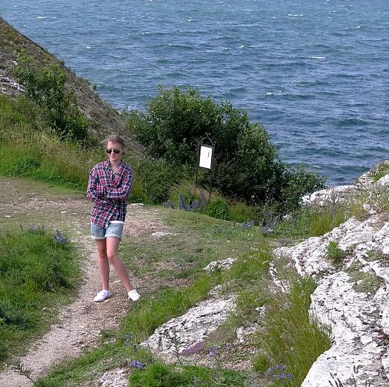 plaid smile girl a bit windy ocean view sight limestone photo