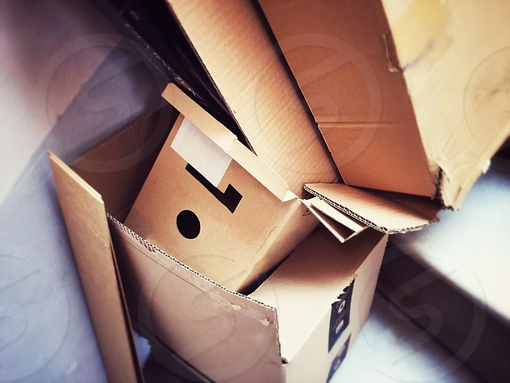 A group of open cardboard containers discarded on the stairs photo