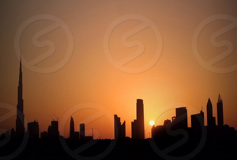 silhouettes of buildings during sunset photo