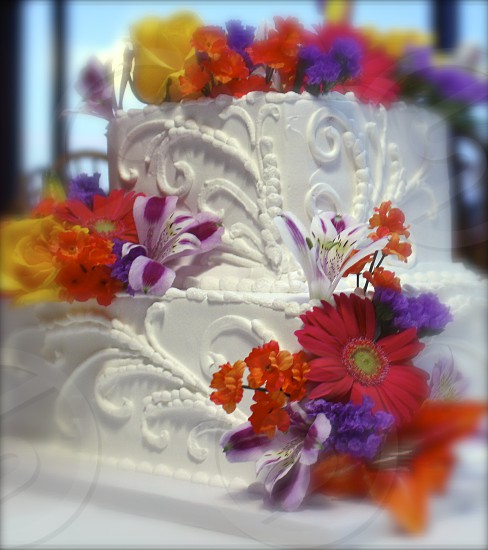 Wedding cake with bright flowers photo