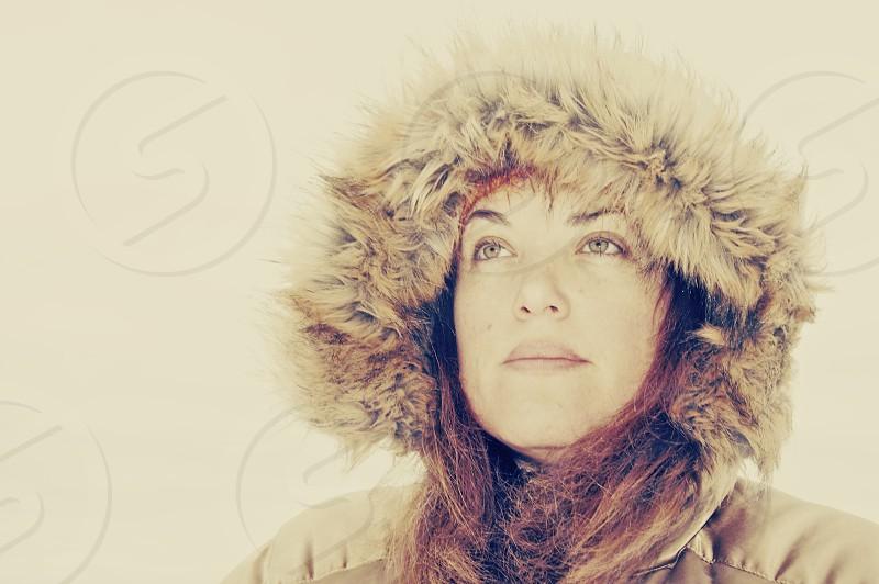 woman in tan coat with fur hood photo