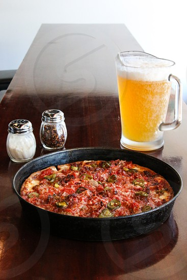 Pizza and beer photo